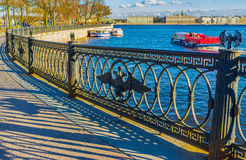 Beautiful railings. Beautiful metal railings decorated with double eagles and two double-bitted axes connecting Ioanovsky and Trinity bridges in Saint Petersburg Stock Photography