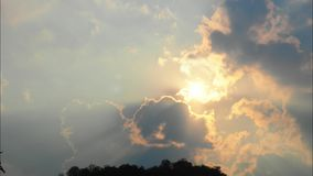 Beautiful rain clouds moving in blue sky. Time Lapse of sun and sky stock video