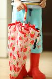 Children in rainboots colourful wear pretty cool and umbrellas stock photos