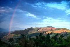 Beautiful rainbow across Mountain thailand. Stock Image