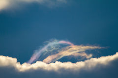 Beautiful rainbow color cloud on blue sky background Stock Images