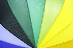 Beautiful rainbow colored umbrella pattern. Beautiful rainbow colored summer umbrella pattern   background Royalty Free Stock Photo