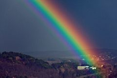 Beautiful rainbow in dark blue sky Royalty Free Stock Photography