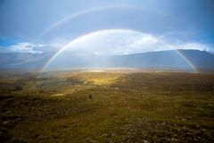Free Beautiful Rainbow In The Valley Between Mountains. Little Stream Royalty Free Stock Photo - 91926115