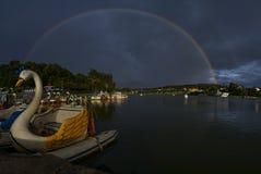 Raibow on the lake. Beautiful rainbow on the lake at Dalat city, Vietnam Royalty Free Stock Images
