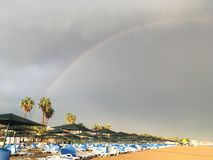 Beautiful rainbow over a deserted Turkish beach royalty free stock image