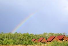Beautiful rainbow over houses. Stock Photo