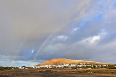 Beautiful rainbow over the mountain Stock Images