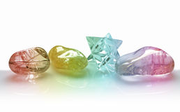 Beautiful rainbow quartz crystals. Clear, rutilated and merkabah crystals with rainbow coloring on a white background royalty free stock image