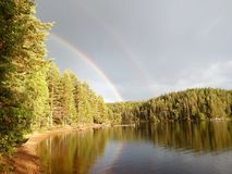 A Rainbow near a beautiful lake. A beautiful rainbow after the rain in the region of Ludvika Royalty Free Stock Image