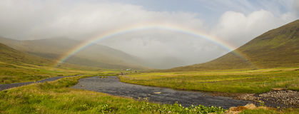A beautiful rainbow in a wild landscape Royalty Free Stock Photography