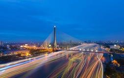 Beautiful Rama 8 Bridge crosses Chao Phraya the river with speed. Light at dusk, Bangkok Thailand Stock Photo