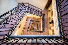 Beautiful ramp and stairs that turns, seen from above, inside a building royalty free stock photos
