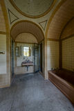 Vintage Brown and Yellow Tiled Bathroom with Fixtures - Abandoned Mansion royalty free stock photos