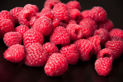 Beautiful raspberries on a black background Stock Photos