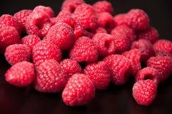 Beautiful raspberries on a black background Stock Photos