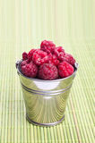 Beautiful raspberries in bucket. Background, food, fruit Stock Photos