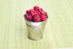 Beautiful raspberries in bucket. Background, food, fruit Stock Image