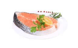 Beautiful raw salmon steak with herbs. Isolated on a white background Stock Photo