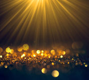 Beautiful rays of light with glitter lights grunge background, g Stock Photos