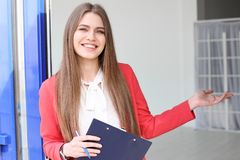 Beautiful real estate agent with clipboard. Outdoors Royalty Free Stock Photography