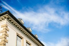 Beautiful real estate property house building on a warm day. With summer blue sky and scattered clouds Stock Photos