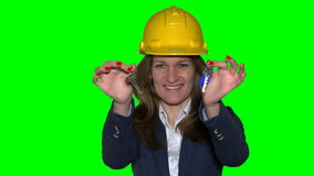 Beautiful realtor business woman with helmet hold new house construction keys. Beautiful young realtor business woman with helmet hold new house construction stock video footage