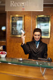 Beautiful receptionist posing with cash card Stock Photos
