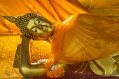 Beautiful reclining golden Buddha Image Stock Photos