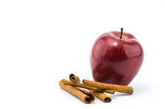 Beautiful red apple and cinnamon. Beautifull red apple and cinnamon on  white backgrund Royalty Free Stock Photography