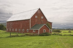 Beautiful Red Barn and Clouds Stock Images
