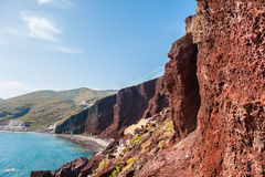 Beautiful Red Beach with turquoise water and big rocks Stock Images