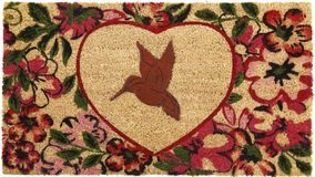 Beautiful red bird peach color coir doormat with heart shape flower border. Isolated on a White Background royalty free stock images