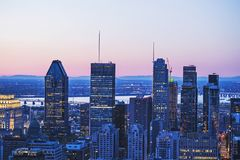 Beautiful red and blue sky and sunrise light over Montreal city in the morning time. Amazing view from Mont-Royal with modern. Architecture. Stunning panorama stock image