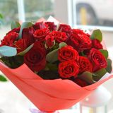 Beautiful red bouquet on white table stock photography