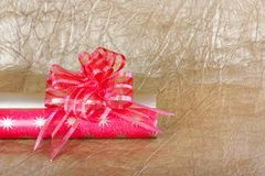 Beautiful red bow for gift decoration on gold background. Royalty Free Stock Photography