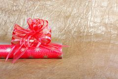 Beautiful red bow for gift decoration on  gold background. Stock Photo