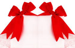 Beautiful red bows over blank card Royalty Free Stock Photography
