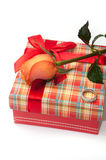 Beautiful red box with red bow, orange rose and engagement ring.  stock image