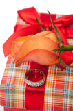 Beautiful red box with red bow, orange rose and engagement ring Stock Images