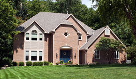 Beautiful Red Brick Home. Beautiful, exclusive, red brick house in suburban neighborhood Royalty Free Stock Photography