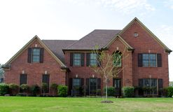 Beautiful Red Brick Residential Home. A Very nice Red Bricked Residential Home in a suburban area outside of Memphis, Tennessee Royalty Free Stock Images