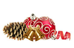 Beautiful red Christmas balls, golden bells and pine cone Stock Photo