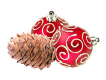 Beautiful red Christmas balls and pine cone isolated on white Royalty Free Stock Images