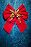 Beautiful red christmas bow with gold ribbon and little bells on Royalty Free Stock Photography