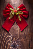 Beautiful red christmas bow with gold ribbon and little bells on Stock Images