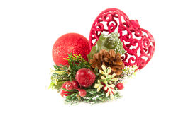 Beautiful Red Christmas Decorations. Beautiful Christmas decorations  including a heart a bauble and a pinecone pick Stock Images