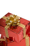 Beautiful red Christmas gifts with gold bow Royalty Free Stock Photo