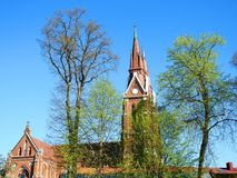 Beautiful red church in spring, Lithuania Royalty Free Stock Image