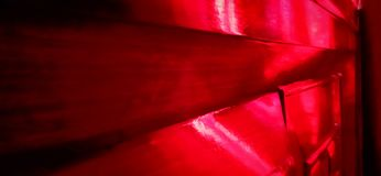 Red color shade. Beautiful red color shade on wood royalty free stock photography
